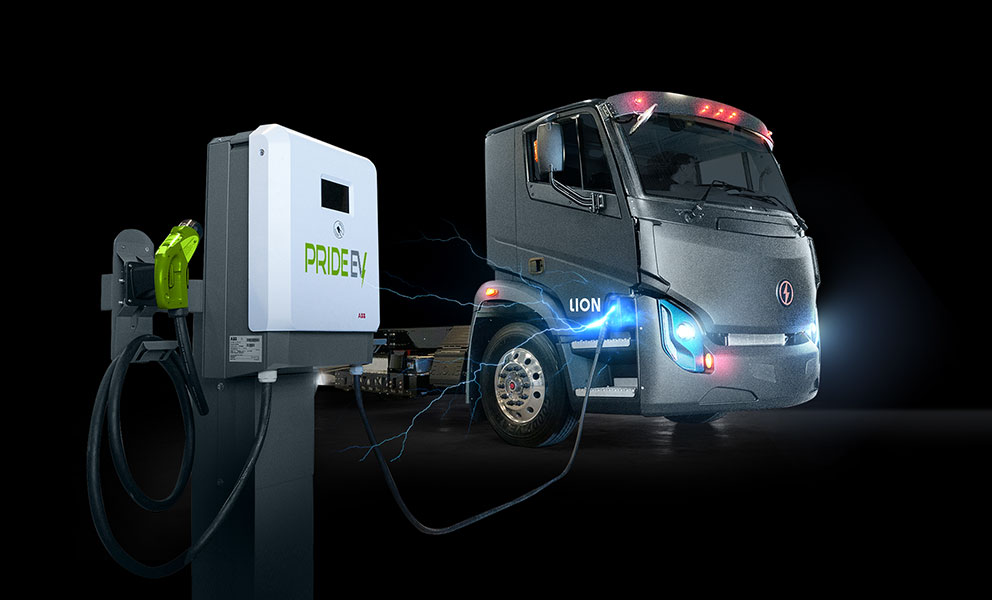 Lion Electric truck connected to Pride EV charger with lightning bolts coming from charging port